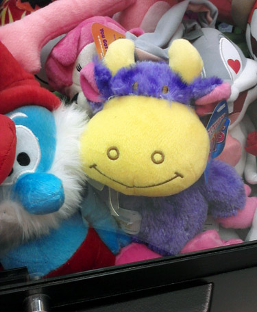 Purple cow in a claw machine
