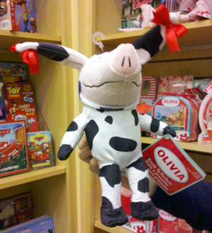 Olivia the pig in a cow costume