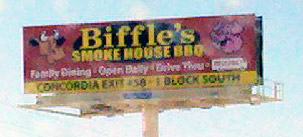 Billboard for Biffle's BBQ - Cow and Pig