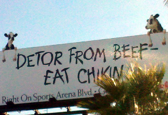 Chick-fil-A billboard with hanging cows