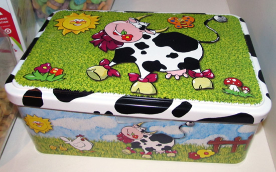 Happy cows on a metal box
