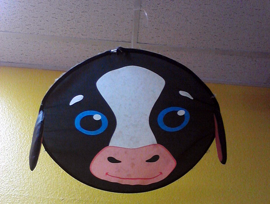 Smiling, happy cow head hanging from the ceiling