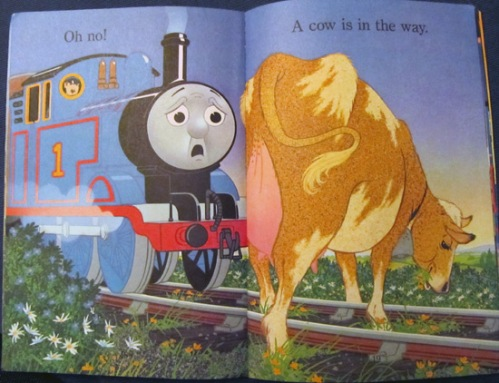 Thomas the Train stopped in his tracks by a cow