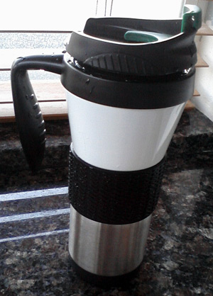 Starbucks travel mug with no cows on it