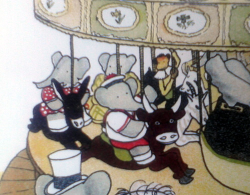 Cow on old carousel in Babar the King book