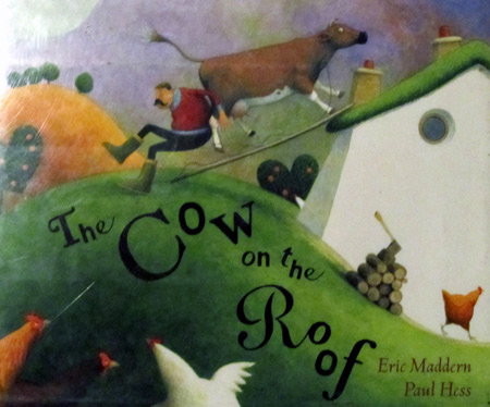 There's a cow on the roof by Eric Maddern
