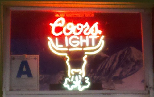 Coors Light with longhorn bull blowing smoke