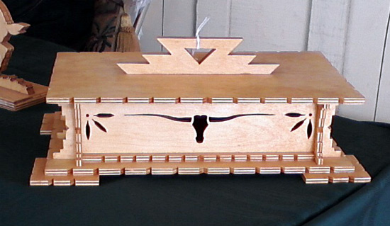 Wooden box with cow skull decoration