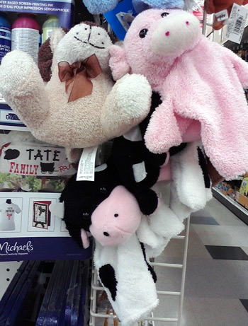 Cow puppet and pig puppet at Michael's