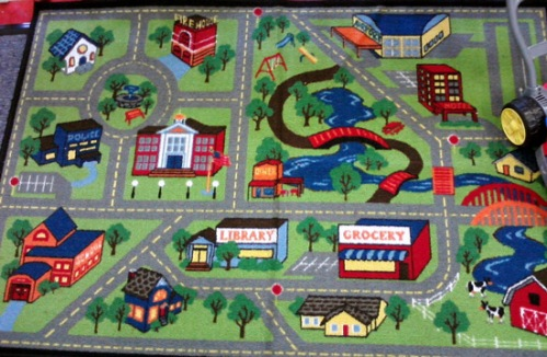 Play rug with roads and houses
