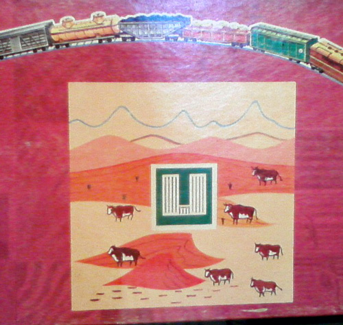 Square Mile board game with cows on box