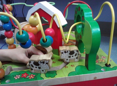 Wooden farm activity cube with cows