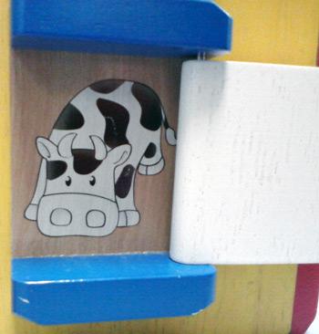 Cow on wooden farm activity cube