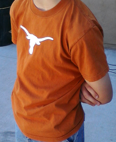 Texas Longhorns logo on orange T-shirt