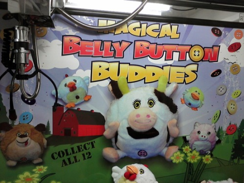 Claw machine with cow and other farm animals