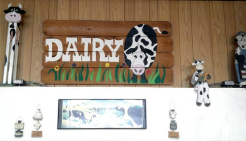 Dairyland signs and cow images at the San Diego Farmers' Outlet store