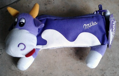 Milka cow with belly stuffed with Milka chocolate