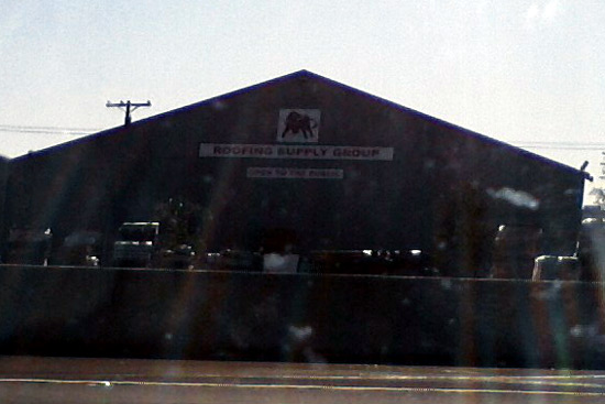 San Diego Roofing Supply sign with red bull logo