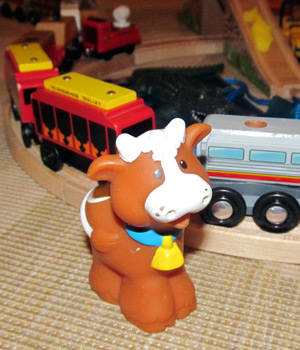 Happy cow watches train go by