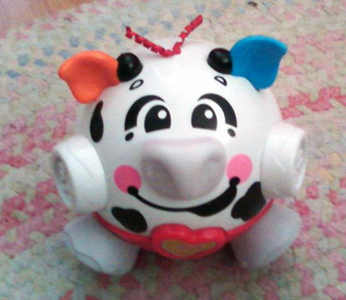 Fisher Price bounce and giggle cow baby toy
