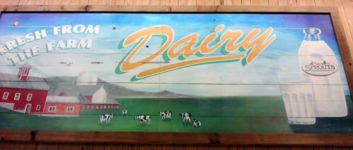 Sprouts farmer's market store - dairy aisle sign with cows