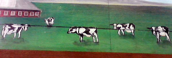 Cows on Sprouts farmer's market dairy sign