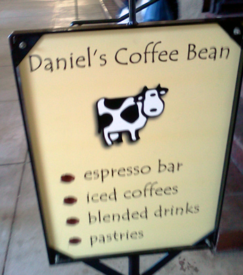 Daniel's Coffee Bean sign with a cow in San Diego's Balboa Park