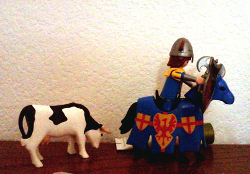 Playmobil knight and Playmobil cow