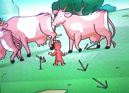 Curious George diverting the cows