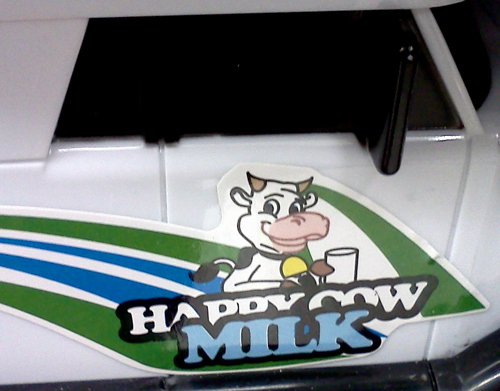 Happy cow milk logo on milk truck