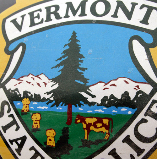 Vermont State police badge with a cow and a pig