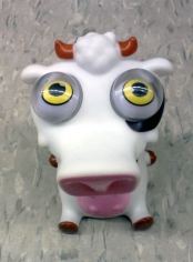 Weird looking cow toy with bug eyes