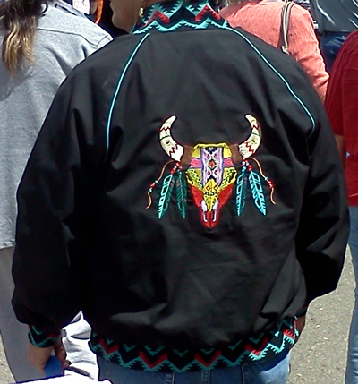Colorful Indian cow skull art rendition on jacket