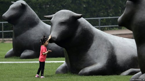 Giant cow sculptures in Shanghai, China - Copyright BBC News