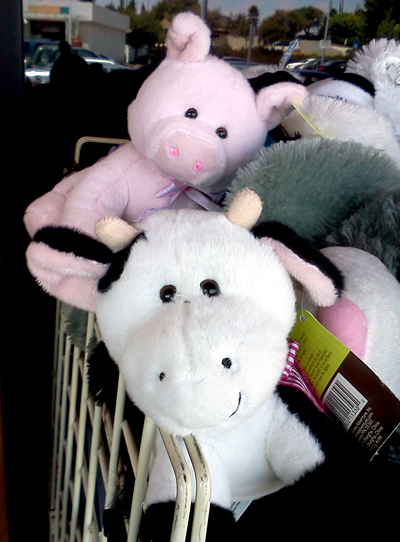 Cow puppet and pig puppet