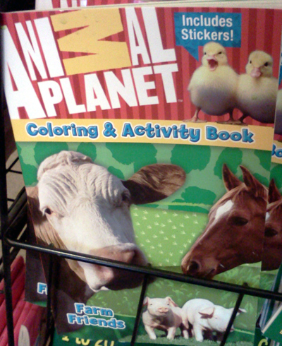 Animal Planet coloring & activity book with a cow