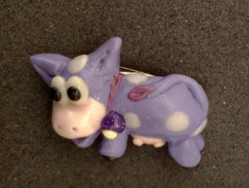Purple cow brooch
